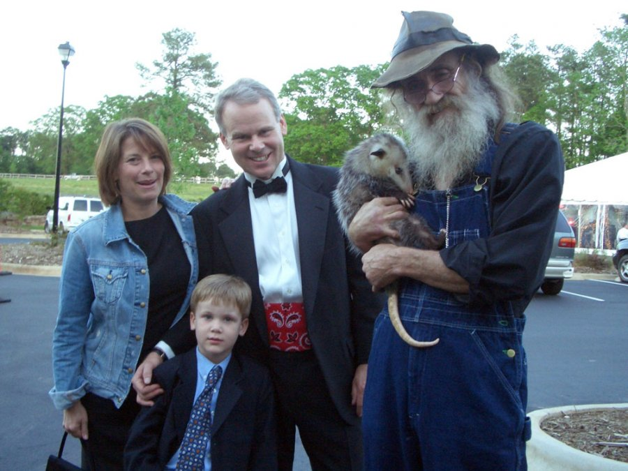 "This was George (the Possum's) first ""Black Tie"" affair. He was a little nervous, but the folks at the Grand Opening of Historic Yates Mill in Raleigh, NC were glad he made it. He was the hit of the night… actually I think he had a little too much Shine!!"